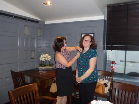 Out going Pres. Cheryl Payan pins incoming President Tamie Frasier