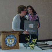 Past President Andrea Knowlton receives President's Book
